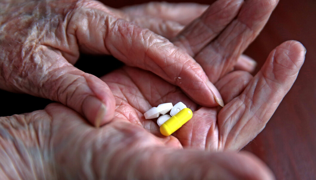 A pensioner with her daily prescription drugs.