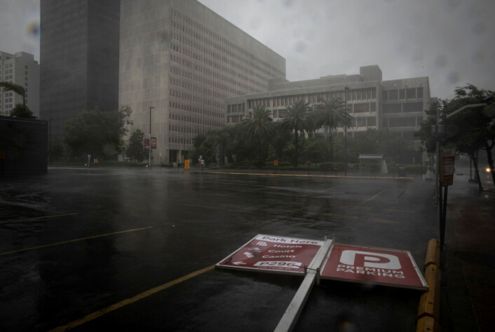 A parking sign lies in the street as Hurricane Ida makes landfall in Louisiana, in New Orleans.