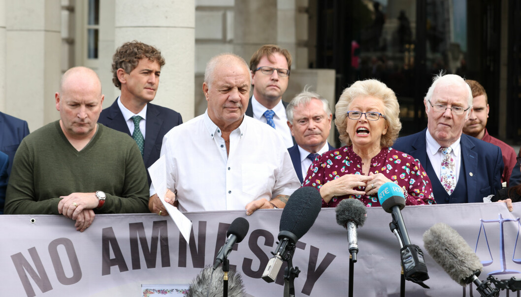 Julie Hambleton (centre right) speaking outside Belfast City Hall after a meeting of victims of The Troubles