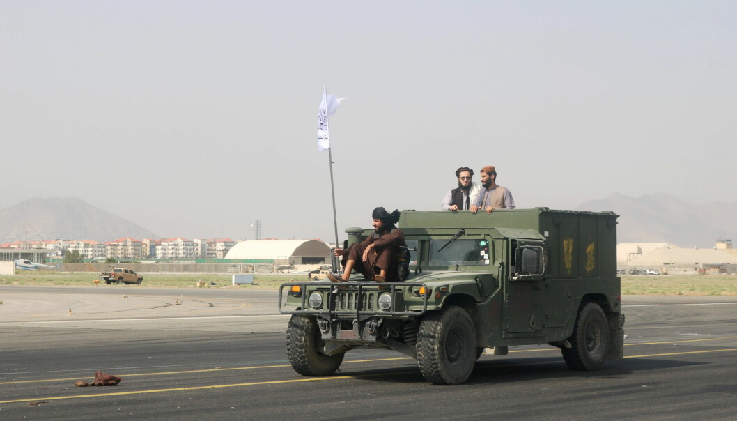 Taliban forces patrol at a runway a day after the U.S. troops withdrawal from Hamid Karzai international airport, Kabul.