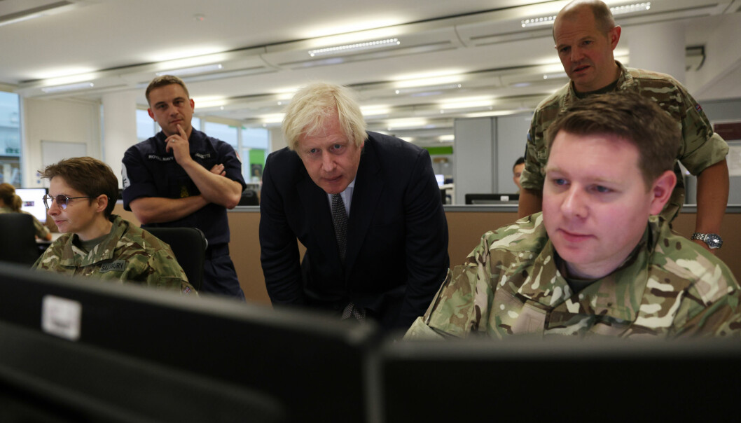 Prime Minister Boris Johnson observes the operations room for the Afghan Relocation and Assistance Policy during a visit to Northwood Headquarters, the British Armed Forces Permanent Joint Headquarters, in Eastbury, north west London, where he met with personnel working on the UK operation in Afghanistan. Picture date: Thursday August 26, 2021.