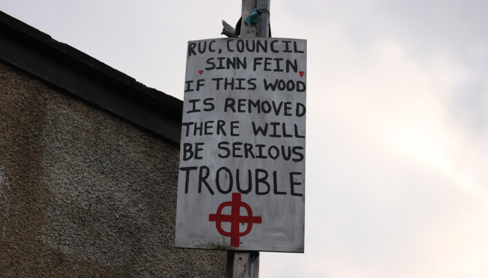 A sign posted on a lamppost near to the site of a large bonfire being built to mark the Catholic Feast of the Assumption in the Bogside area of Londonderry, Northern Ireland. Picture date: Sunday August 15, 2021.