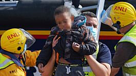 A baby and several young children amongst large group of migrants brought ashore as Channel crossings continue