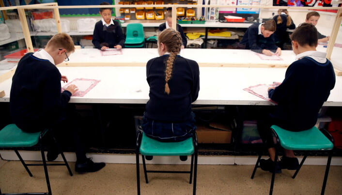 Covid: Pupils asked to clean desks and wear face masks in corridors as schools reopen