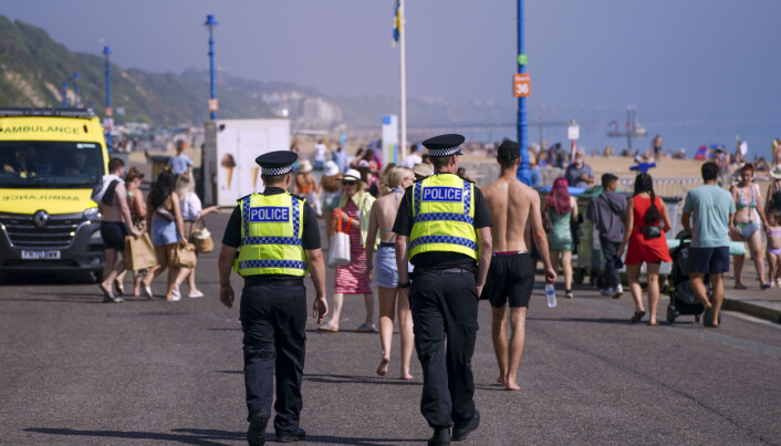 Police officers patrol the promenade as people enjoy the warm weather on Bournemouth Beach in Dorset. Picture date: Monday September 6, 2021.
