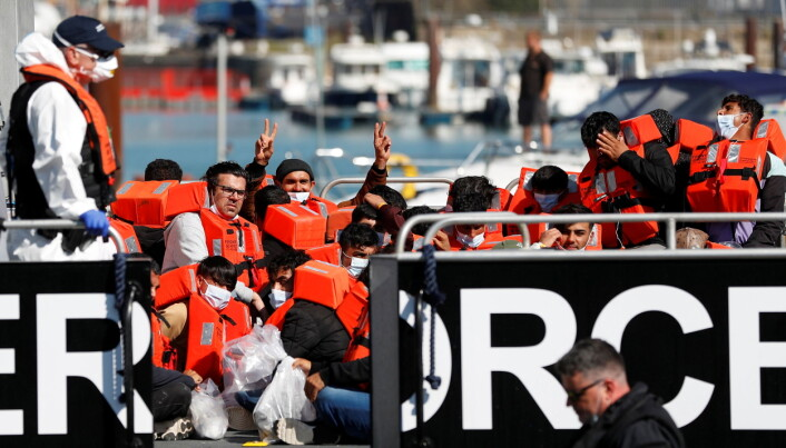 Migrants rescued from the English Channel are brought into Dover on the Border Force Catamaran Rescue Boat, BF Hurricane