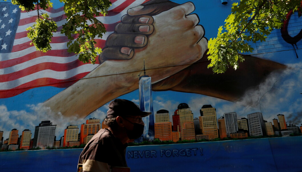 A man walks by a 9/11 memorial mural in the Bronx borough of New York City, U.S.