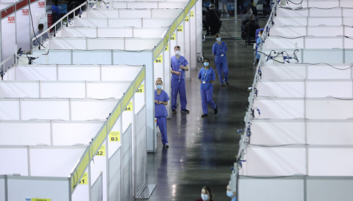 Medical staff at a vaccine clinic at the SSE Arena, Belfast, during the The Big Jab Weekend.