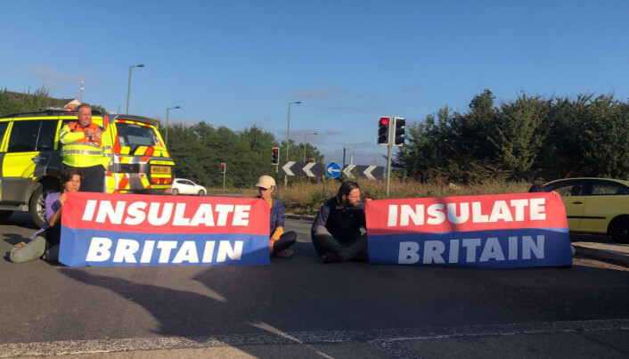 Handout photo issued by Insulate Britain of protesters taking part in blocking the M25 motorway in London. Issue date: Wednesday September 15, 2021.