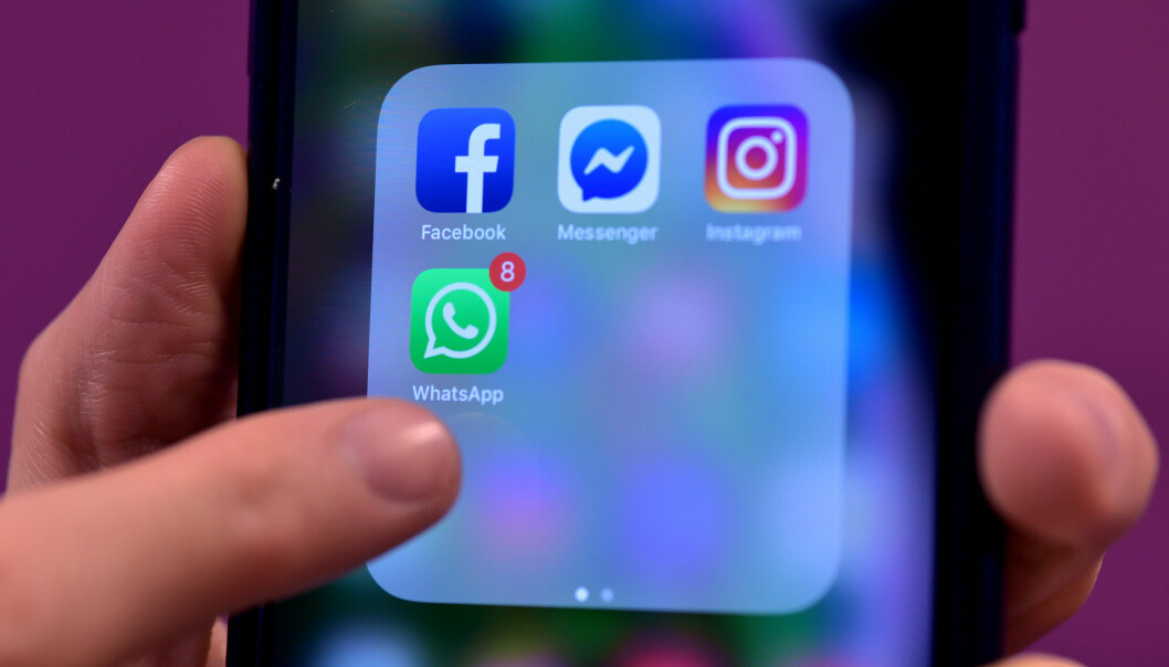 Stock photo of Facebook, Messenger, Instagram and WhatsApp, social media app icons on a smart phone.