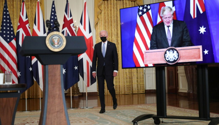 U.S. President Joe Biden walks to the podium before his remarks on a National Security Initiative virtually with Australian Prime Minister Scott Morrison and British Prime Minister Boris Johnson, inside the East Room at the White House in Washington, U.S.