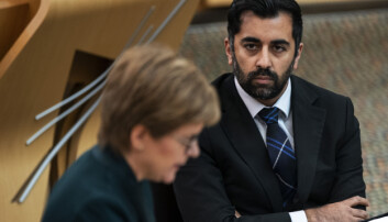 Humza Yousaf, Cabinet Secretary for Health and Social Care listens to Scotland's First Minister Nicola Sturgeon.