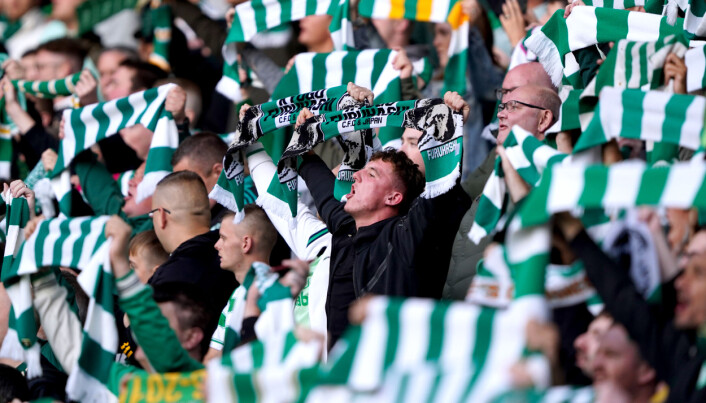 Celtic fans in the stands hold up scarves in support of Kyogo Furuhashi ahead of the UEFA Europa League Play-off, first leg match at Celtic Park.