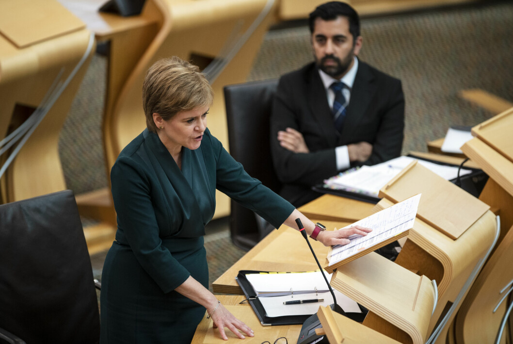 Scotland's First Minister Nicola Sturgeon, watched by Humza Yousaf, Cabinet Secretary for Health and Social Care, speaks during First Minster's Questions at the Scottish Parliament in Holyrood, Edinburgh. Picture date: Thursday September 16, 2021.