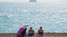 Weather: Warm and sunny, with sporadic showers