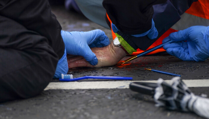 Police officers work to free protesters who had glued themselves to a slip road at Junction 4 of the A1(M), near Hatfield, where climate activists carried out a further action after demonstrations which took place last week across junctions in Kent, Essex, Hertfordshire and Surrey.