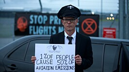 Extinction Rebellion stage protest at airport against private jet emissions