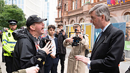 Conservative conference: Jacob Rees-Mogg confronted by disability campaigner in street over Tory policies