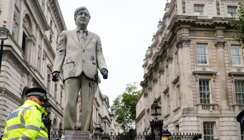 Cambo: Greenpeace protesters cover Boris Johnson statue in oil outside Downing Street