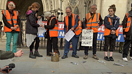Insulate Britain protesters set light to court injunction papers outside Royal Courts of Justice in London