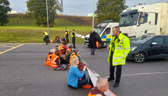 Insulate Britain of protesters from Insulate Britain blocking the M25 at junction 31, near to the Dartford Crossing in Thurrock, Essex.