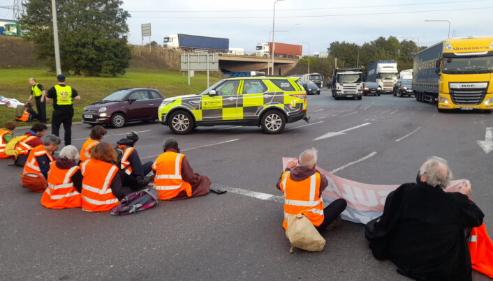 Handout photo issued by Insulate Britain of protesters from Insulate Britain blocking the M25 at junction 31, near to the Dartford Crossing in Thurrock, Essex. Picture date: Wednesday October 13, 2021.