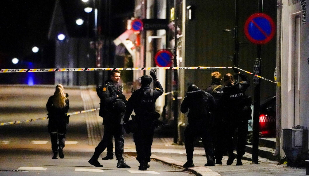 Police officers investigate after several people were killed and others were injured by a man using a bow and arrows to carry out attacks, in Kongsberg, Norway, October 13, 2021..