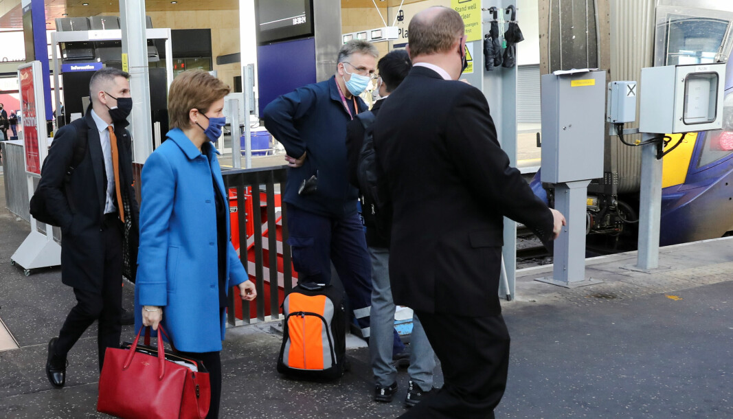 First Minister Nicola Sturgeon walks to board a train at the relaunch of Glasgow Queen Street station in Glasgow