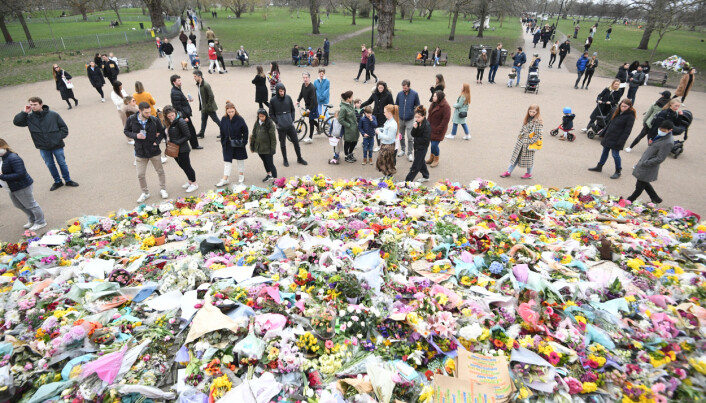 File photo dated 21/03/2021 of people viewing floral tributes left at the bandstand in Clapham Common, London, for Sarah Everard.
