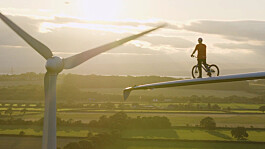 Cop26: Pro-cyclist performs stunt on wind turbine to raise awareness of climate change